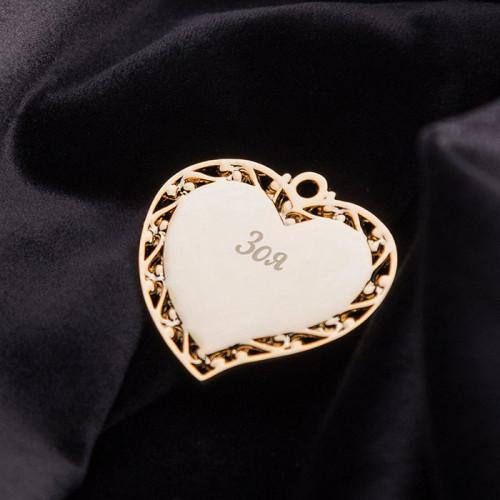 Лазерная гравировка на кулоне в виде сердца (пример)